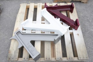 Stages of Liquid Penetrant Inspection (Red Dye, White Developer, Gray Finished Casting)
